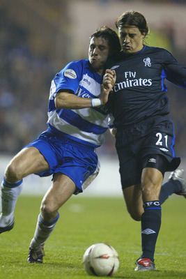 Reading's John Mackie (left) in action against Chelsea