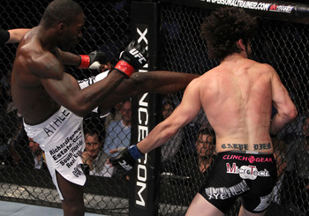 Anthony Johnson (L) delivers a head kick - Josh Hedges/Zuffa, LLC