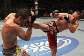 Duane Ludwig (R) launces a head kick - Josh Hedges/Zuffa, LLC