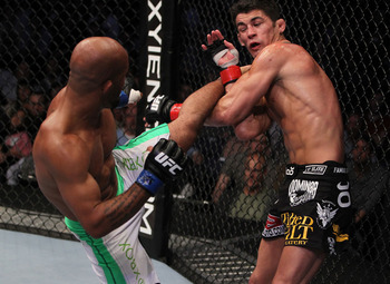 Demetrious Johnson (L) delivers a head kick - Josh Hedges/Zuffa, LLC