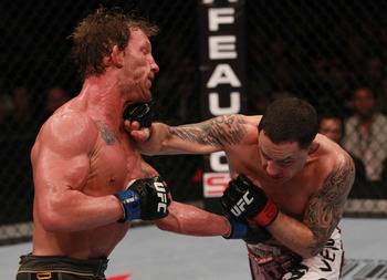 Frankie Edgar (R) lands a right hand - Nick Laham/Zuffa, LLC