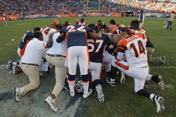 DENVER, CO - SEPTEMBER 18:  Members of the Cincinnaati Bengals nd the Denver Broncos meet for prayer following their game at Sports Authority Field at Mile High on September 18, 2011 in Denver, Colorado. The Broncos defeated the Bengals 24-22.  (Photo by
