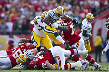 KANSAS CITY, MO - DECEMBER 18:   Ryan Grant #25 of the Green Bay Packers runs the ball against the Kansas City Chiefs at Arrowhead Stadium on December 18, 2011 in Kansas CIty, Missouri.  The Chiefs defeated the Packers 19-14.   (Photo by Wesley Hitt/Getty