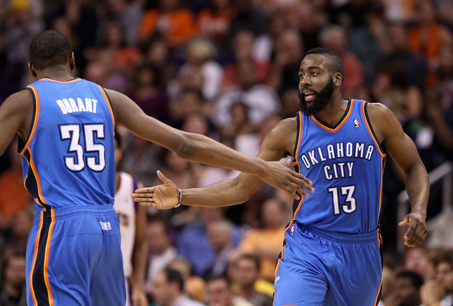 PHOENIX, AZ - MARCH 30:  James Harden #13 of the Oklahoma City Thunder high fives teamate Kevin Durant #35 after scoring against the Phoenix Suns during the NBA game at US Airways Center on March 30, 2011 in Phoenix, Arizona. The Thunder defeated the Suns
