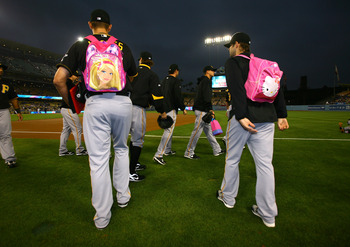 Could Yelich and Ozuna be sporting the pretty book bags as part of their rookie hazing in 2015?