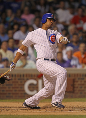 CHICAGO, IL - AUGUST 24:  Carlos Pena #22 of the Chicago Cubs takes a swing against the Atlanta Braves at Wrigley Field on August 24, 2011 in Chicago, Illinois. The Cubs defeated the Braves 3-2.  (Photo by Jonathan Daniel/Getty Images)