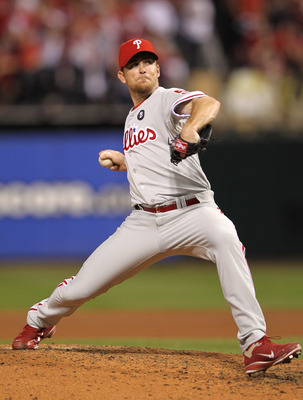 ST LOUIS, MO - OCTOBER 05:  Brad Lidge #54 of the Philadelphia Phillies pitches in the eighth inning against the St. Louis Cardinals in Game Four of the National League Division Series at Busch Stadium on October 5, 2011 in St Louis, Missouri.  (Photo by