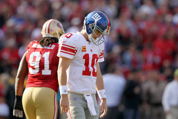 SAN FRANCISCO, CA - NOVEMBER 13:  Eli Manning #10 of the New York Giants walks off the field after throwing an interception against the San Francisco 49ers at Candlestick Park on November 13, 2011 in San Francisco, California.  (Photo by Ezra Shaw/Getty I