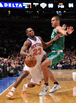 NEW YORK, NY - DECEMBER 25: Toney Douglas #23 of the New York Knicks drives to the basket against Sasha Pavlovic #11 of the Boston Celtics during the second half at Madison Square Garden on December 25, 2011 in New York City. NOTE TO USER: User expressly