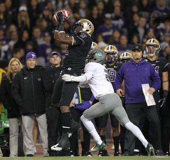 SEATTLE - NOVEMBER 05:  Wide receiver Kasen Williams #2 of the Washington Huskies makes a catch against Troy Hill #2 of the Oregon Ducks on November 5, 2011 at Husky Stadium in Seattle, Washington. Oregon won 34-17. (Photo by Otto Greule Jr/Getty Images)