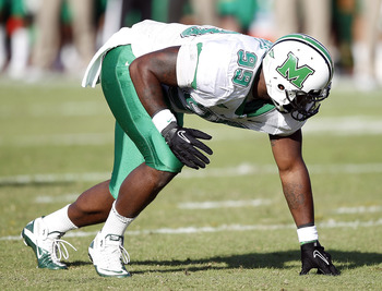 HOUSTON - OCTOBER 22:  Defensive lineman Vinny Curry #99 of the Marshall Thundering Herd lines up against the Houston Cougars at Robertson Stadium on October 22, 2011 in Houston, Texas.  (Photo by Bob Levey/Getty Images)