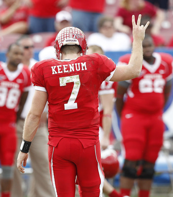 HOUSTON - DECEMBER 03:  Quarterback Case Keenum #7 of the Houston Cougars salutes the crowd for the last time after scoring in the fourth quarter against the Southern Miss Golden Eagles during the Conference USA championship game at Robertson Stadium on D