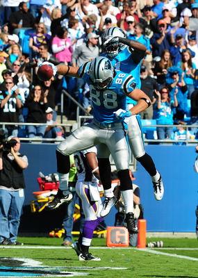 Cam Newton (1) and Greg Olsen (88) celebrate a Panthers touchdown