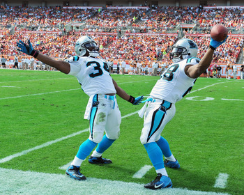 "DeAngelo Williams (34) and Jonathan Stewart (28) are ""Double Trouble."""