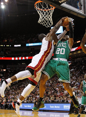 MIAMI, FL - DECEMBER 27: Dwyane Wade #3 of the Miami Heat blocks Ray Allen #20 of the Boston Celtics during a game  at American Airlines Arena on December 27, 2011 in Miami, Florida. NOTE TO USER: User expressly acknowledges and agrees that, by downloadin
