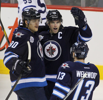 The Jets celebrate after Andrew Ladd's goal, which was scored seconds after a Toronto penalty had expired