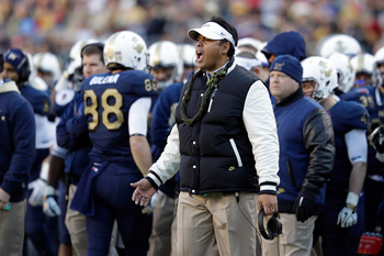 LANDOVER, MD - DECEMBER 10:  Head coach Ken Niumatalolo of the Navy Midshipmen motions to the field during the second half against the Army Black Knights at FedEx Field on December 10, 2011 in Landover, Maryland.  (Photo by Rob Carr/Getty Images)