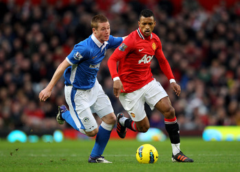 MANCHESTER, ENGLAND - DECEMBER 26:  James McCarthy of Wigan Athletic competes with Nani of Manchester United during the Barclays Premier League match between Manchester United and Wigan Athletic at Old Trafford on December 26, 2011 in Manchester, England.