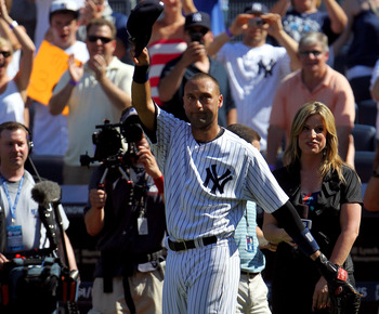 Derek Jeter takes a curtain call at Yankee Stadium after homering for his 3000th hit.