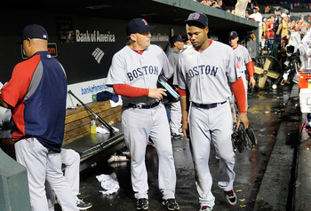 A dejected Carl Crawford vacates the Red Sox dugout in Baltimore after the collapse was complete.