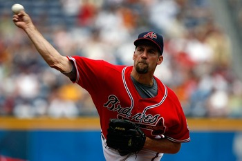John Smoltz won over 200 games. He also saved over 150 games.