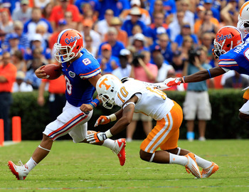 GAINESVILLE, FL - SEPTEMBER 17:  Trey Burton #8 of the Florida Gators attempts to run past defensive back Marsalis Teague #10 of the Tennessee Volunteers during a game at Ben Hill Griffin Stadium on September 17, 2011 in Gainesville, Florida.  (Photo by S