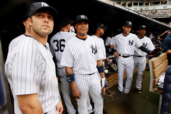 NEW YORK, NY - SEPTEMBER 24: The New York Yankees wait in the dugout against the Boston Red Sox on September 24, 2011 at Yankee Stadium in the Bronx borough of New York City.  (Photo by Nick Laham/Getty Images)