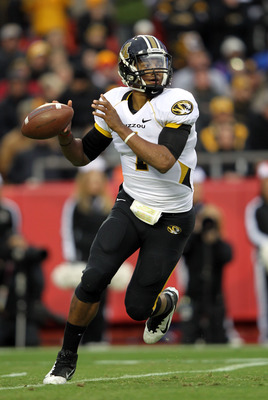 KANSAS CITY, MO - NOVEMBER 26:  Quarterback James Franklin #1 of the Missouri Tigers passes during the game against the Kansas Jayhawks on November 26, 2011 at Arrowhead Stadium  in Kansas City, Missouri.  (Photo by Jamie Squire/Getty Images)