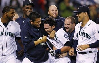 Remember these smiles? Felix and the boys celebrate after a walk-off win in 2011