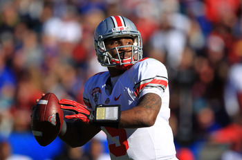 JACKSONVILLE, FL - JANUARY 02:  Quaterback Braxton Miller #5 of Ohio State Buckeyes looks to pass during the first half at the TaxSlayer.com Gator Bowl against the Florida Gators at EverBank Field on January 2, 2012 in Jacksonville, Florida.  (Photo by Sc