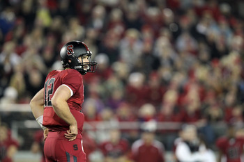 STANFORD, CA - NOVEMBER 26:  Andrew Luck #12 of the Stanford Cardinal in action against the Notre Dame Fighting Irish at Stanford Stadium on November 26, 2011 in Stanford, California.  (Photo by Ezra Shaw/Getty Images)