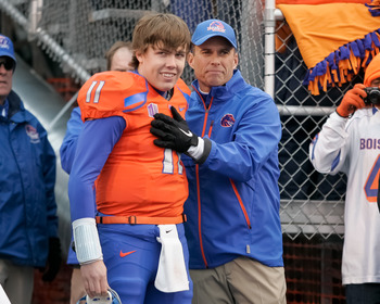 BOISE, ID - DECEMBER 03: Head Coach Chris Petersen congratulates Kellen Moore #11 of the Boise State Broncos before his Senior Day introduction before the game against the New Mexico Lobos at Bronco Stadium on December 3, 2011 in Boise, Idaho.  (Photo by