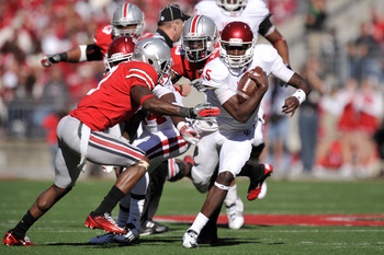 COLUMBUS, OH - NOVEMBER 5:  Travis Howard #7 of the Ohio State Buckeyes attempts to tackle quarterback Tre Roberson #5 of the Indiana Hoosiers at Ohio Stadium on November 5, 2011 in Columbus, Ohio. Ohio State defeated Indiana 34-20.   (Photo by Jamie Saba