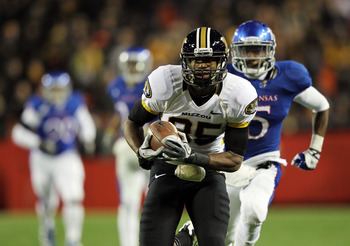 KANSAS CITY, MO - NOVEMBER 26:  Marcus Lucas #85 of the Missouri Tigers is hoisted carries the ball into the end zone  for a touchdown after making a catch during the game against the Kansas Jayhawks on November 26, 2011 at Arrowhead Stadium  in Kansas Ci