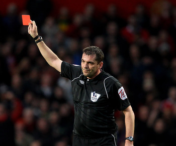 Phil Dowd brandishes a red.