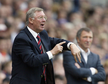 Sir Alex Ferguson conducts the referee