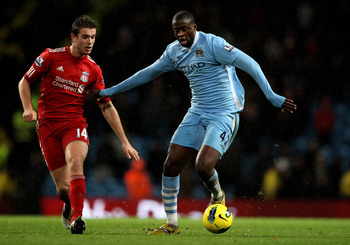 Yaya Toure navigates the threat of Jordan Henderson