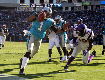 Cam Newton (1) nearly scores a game-winning touchdown, but the play was called back for an illegal block in the back by Steve Smith (89).