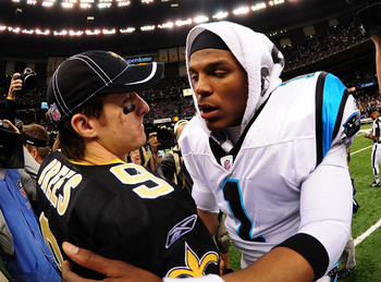 Rookie of the Year and MVP? Newton (1) congratulating Brees (9) on the Saints victory.
