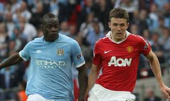 Michaelcarrick-manchesterunited-mariobalotelli-manchestercitycropped_display_image