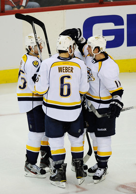 WASHINGTON, DC - DECEMBER 20:  Sergei Kostitsyn #74 of the Nashville Predators celebrates with teammates Craig Smith #15 of the Nashville Predators, Shea Weber #6 of the Nashville Predators, and David Legwand #11 of the Nashville Predators after scoring a