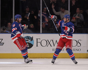 NEW YORK, NY - JANUARY 05:  (L-R) Brad Richards #19 and Marian Gaborik #10 of the New York Rangers celebrate a third period goal against the Florida Panthers at Madison Square Garden on January 5, 2012 in New York City. The Rangers defeated the Panthers 3