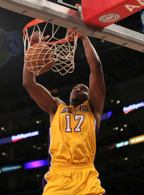 LOS ANGELES, CA - JANUARY 06: Andrew Bynum #17 of the Los Angeles Lakers dunks against the Golden State Warriors at Staples Center on January 6, 2012 in Los Angeles, California.  NOTE TO USER: User expressly acknowledges and agrees that, by downloading an