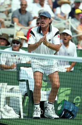 18 Jul 1999:  Captain of the Australian Team John Newcombe encourages Patrick Rafter during the Davis Cup at the Longwood Cricket Club in Chestnut, Massachusetts. Mandatory Credit: Andy Lyons  /Allsport