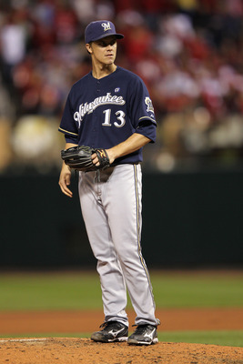 ST LOUIS, MO - OCTOBER 14:  Zack Greinke #13 of the Milwaukee Brewers looks on against the St. Louis Cardinals during Game Five of the National League Championship Series at Busch Stadium on October 14, 2011 in St Louis, Missouri.  (Photo by Jamie Squire/