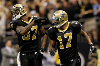 WR Adrian Arrington (87) celebrates with WR Robert Meachem (17).
