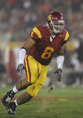 LOS ANGELES, CA - OCTOBER 24:  Nick Perry #8 of the USC Trojans rushes against the Oregon State Beavers on October 24, 2009 at the Los Angeles Coliseum in Los Angeles, California.  USC won 42-36.  (Photo by Jeff Golden/Getty Images)