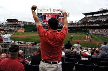 WASHINGTON, DC - SEPTEMBER 25: A fan celebrates after Wilson Ramos #3 of the Washington Nationals (not pictured) hits a homerun against the Atlanta Braves in the fourth inning at Nationals Park on September 25, 2011 in Washington, DC. The Washington Natio