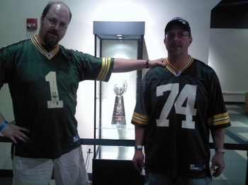 Two of the Green Bay Packers newest owners in a photo op in front of the Super Bowl XLV Lombardi Trophy