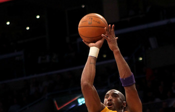 LOS ANGELES, CA - JANUARY 10:  Kobe Bryant #24 of the Los Angeles Lakers shoots over Grant Hill #33 of the Phoenix Suns at Staples Center on January 10, 2012 in Los Angeles, California. NOTE TO USER: User expressly acknowledges and agrees that, by downloa